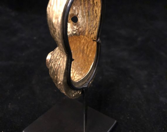 Base of a small gold sculpture